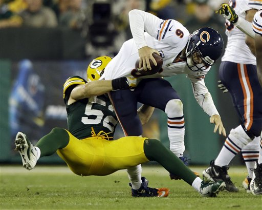 Jay Cutler sacked by Clay Matthews (AP Photo/Jeffrey Phelps).