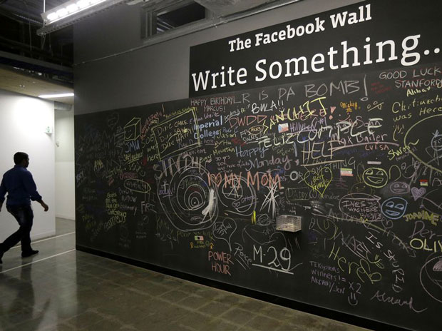 Employees and visitors can leave messages on walls like this on the Facebook campus in Menlo Park, Calif. (Jeff Chlu/AP)