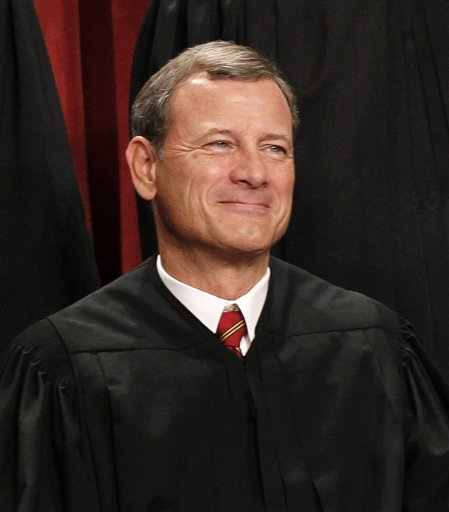 Chief Justice John G. Roberts and blogger Achy Obejas both grew up in Michigan City, Ind. (AP/Pablo Martinez Monsivais, File)