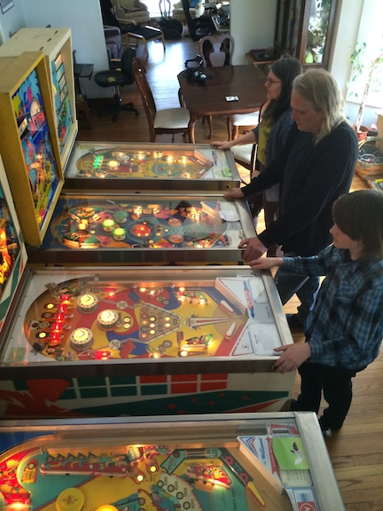 Kevin Schramer plays his pinball machines with his family. Kevin's question began this investigation. (WBEZ/Mickey Capper)