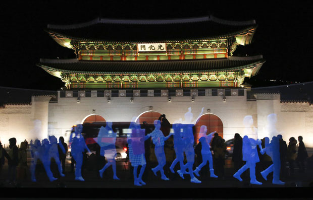 Holograms of human figures are displayed during a 'ghost protest' against South Korea's president in front of the Gyeongbok Palace in Seoul on Wednesday. Amnesty International in Korea said it decided to use the holograms after protesters were denied permission to march. See the video below. (Lee Jin-man/AP)