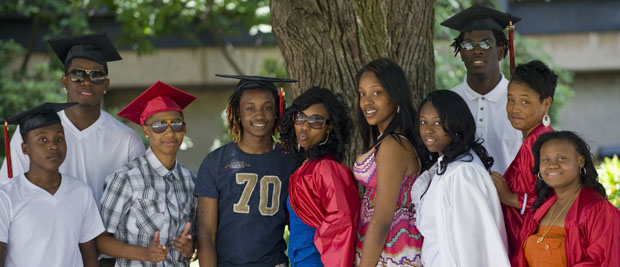 Graduates of Manley High School pose for a photo outside of their graduation. (WBEZ/Bill Healy)