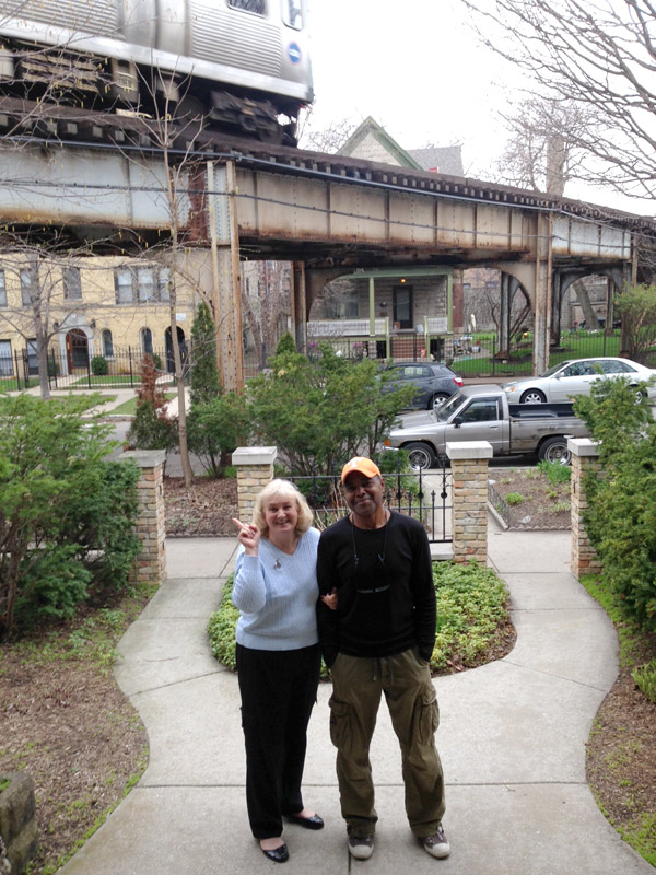 Mary and Floyd have owned a yellow house off the curve of a Brown Line train for the last 25 years. Mary says she has a love-hate relationship with the train. (WBEZ/Logan Jaffe)