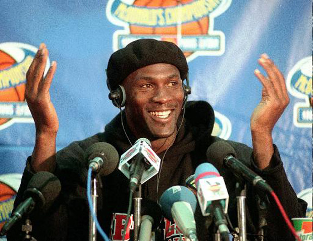 Chicago Bulls player Michael Jordan gestures during a news conference at Bercy stadium in Paris Wednesday Oct. 15, 1997. Michael Jordan is the richest athlete in the world, regaining the top spot on the Forbes magazine list for the fifth time in six years. Jordan will earn dlrs 78.3 million in 1997. (AP Photo/Remy de la Mauviniere)