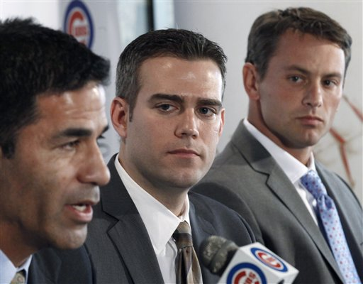 From left: Jason McLeod, Theo Epstein and Jed Hoyer of the Cubs management team during the MLB draft. (AP/Charles Rex Arbogast)