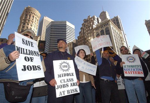 Auto industry workers and supporters demonstrate outside the office of Sen. Diane Feinstein in 2008, when top executives from the Detroit automakers spent two consecutive days on Capitol Hill pleading for $34 billion in loans. (AP/Ron Lewis)