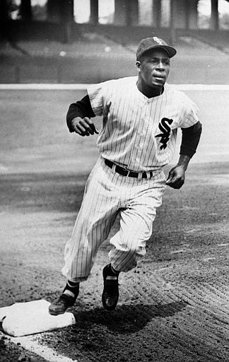 Minnie Minoso rounds the bases at Comiskey Park in 1955. Minoso was the first black man to play for the White Sox. (AP)