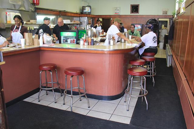 The vintage wrap-around counter inside Moon's Sandwich Shop on the West Side. (WBEZ/Jennifer Brandel)