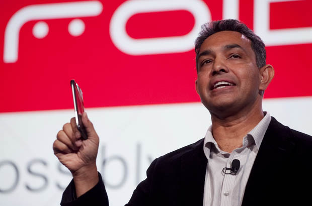 Sanjay Jha, former CEO of Motorola Mobility, holds the Droid Razr, in 2011 in New York. The company once made the best-selling phone in the world, but the rise of touch-screen smart phones hurt the company and its market share. (AP/Mark Lennihan)