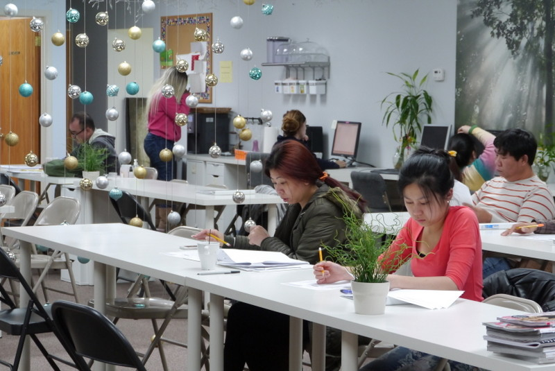 Most of the students at the Botanic School of Nail Technology on Chicago's North Side are native speakers of Vietnamese, Korean, or Chinese. School owner Rosemary Hyunh has crafted a bilingual curriculum to help them pass the written licensing exam in English. (WBEZ/Jian Chung Lee)