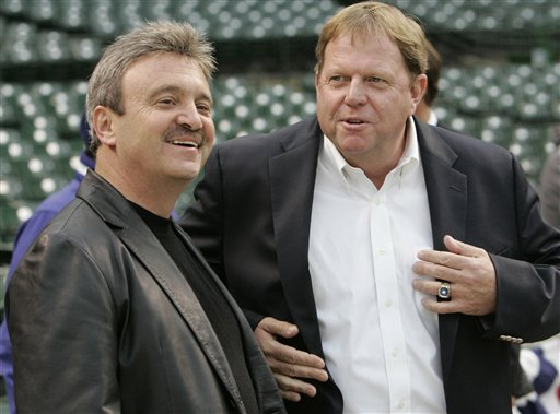 L.A. Dodgers General Manager Ned Colletti and then-Chicago Cubs GM Jim Hendry during the L.A.-Cubs playoffs in 2008. (AP/Nan Y. Huh)
