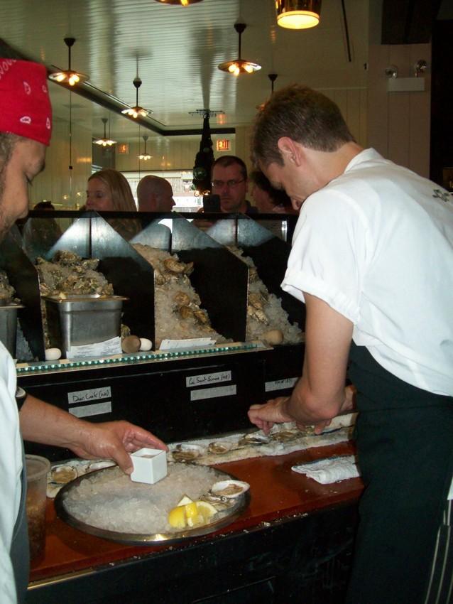 Shuckers prepare oysters at GT Fish & Oyster. (Nina Barrett)