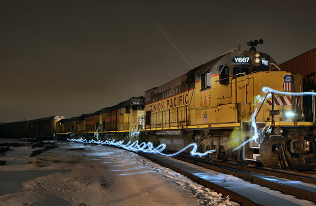 Walking The Train: Taken with permission at the West Chicago yard. A 30 second exposure of a conductor walking down his train. This is the LPW14-06 manifest train from Belvidere, IL They were blocked, and waiting on a stack train which itself was waiting to head South on the CNRR Leithton Sub (Flickr/Duane Rapp)