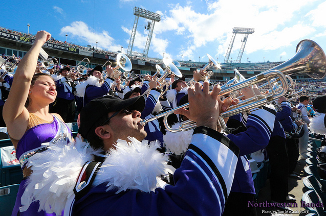 The Northwestern University 'Wildcat' Marching Band celebrates victory at EverBank Field at the 2013 TaxSlayer.com Gator Bowl, where Northwestern competed against Mississippi State on January 1, 2013.  (Flickr/NUBands, Daniel M. Reck)