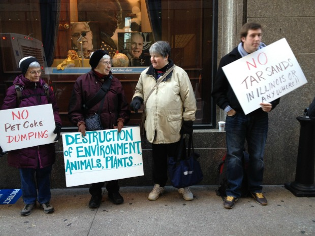 Southeast Side residents protest pet coke piles. (WBEZ/Michael Puente)