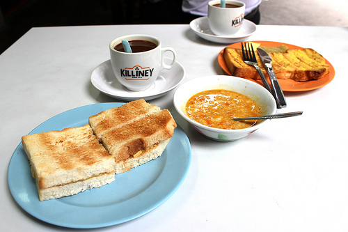 Kaya toast with soft cooked eggs, and coffee in Singapore. (WBEZ/Louisa Chu)