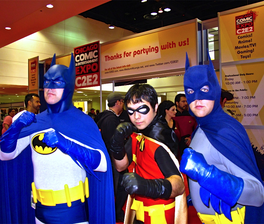 Two Batmans and a Robin at C2E2 2011. (c2e2.com)