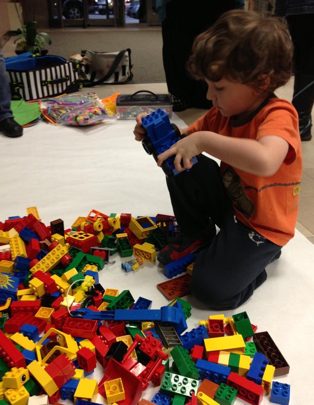 Pritzker school kindergartener, Leo, plays with LEGOs at Chicago Public Schools downtown headquarters. (WBEZ/Becky Vevea)
