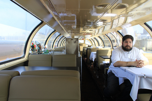 Chef Daniel Traynor sits aboard a refurbished Pullman car before setting off to New Orleans. (WBEZ/Jennifer Brandel)
