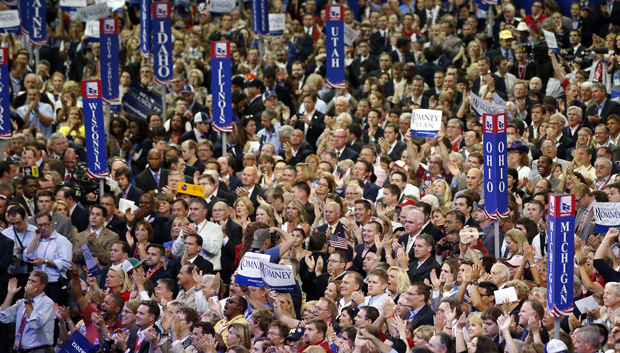 Delegates cheer as Republican vice presidential nominee Rep. Paul Ryan walks to the podium to address the Republican National Convention in Tampa on Wednesday. (AP Photo/Jae C. Hong)