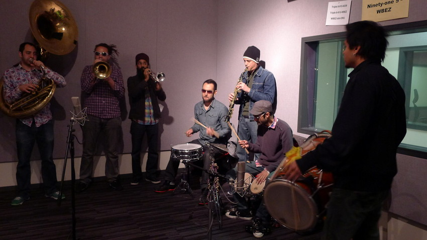 Red Baraat warms up in the studio (WBEZ/Caroline O'Donovan)