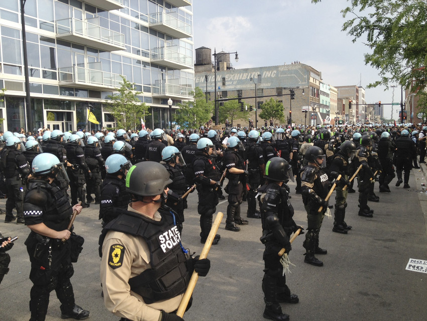 Illinois State police and Chicago police stand guard on Michigan Ave. during a protest march as a part of this weekend's NATO summit Sunday, May 20, 2012, in Chicago. (AP/Robert Ray)