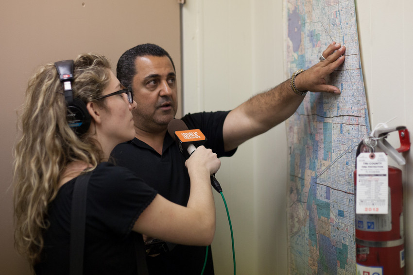 Sadeghi points out routes to reporter Lauren Chooljian. (WBEZ/Shawn Allee)
