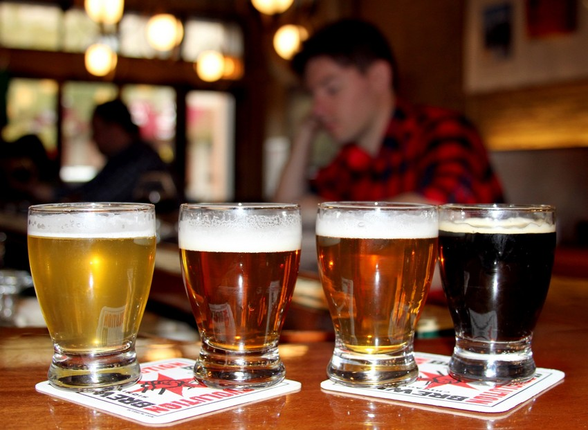 Taster portion of four beers made in-house at Revolution Brewing in Logan Square. (Tricia Bobeda/WBEZ)
