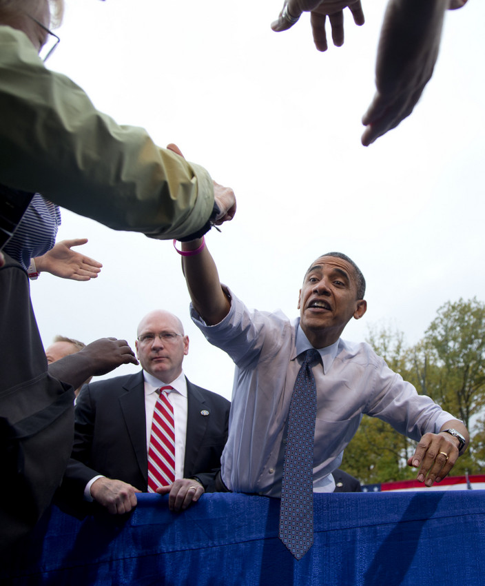 President Barack Obama stretches to shakes hands with supporters after speaking about the choice facing women in the upcoming election. (AP/Carolyn Kaster)