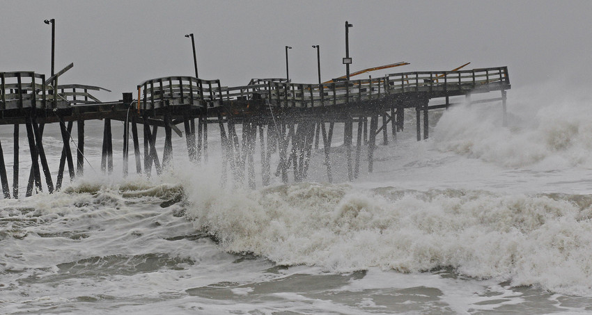 Waves from Hurricane Sandy crash onto the damaged Avalon Pier in Kill Devil Hills, N.C., Monday.  (AP/Gerry Broome)
