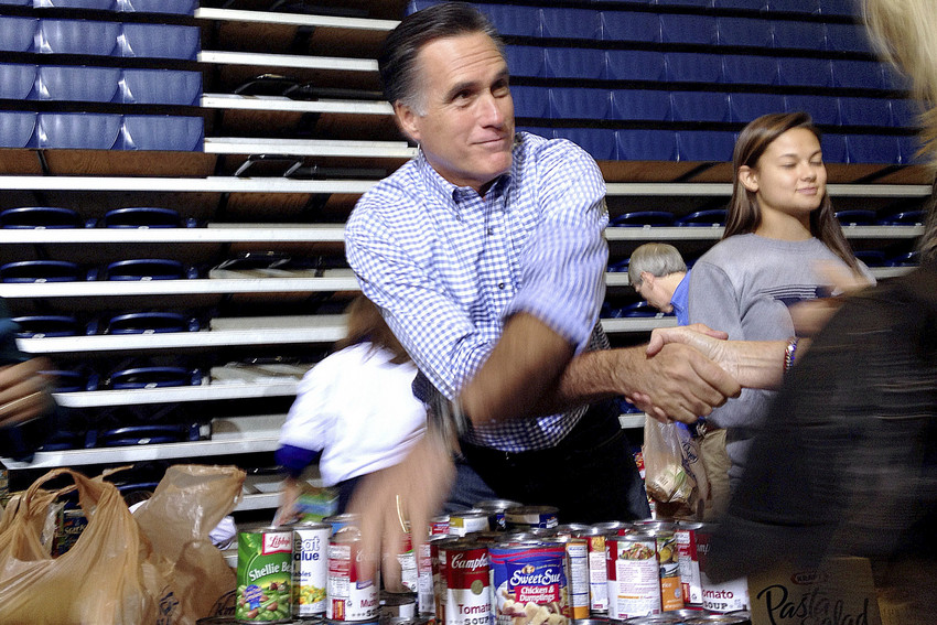 Republican presidential candidate Mitt Romney collects supplies for victims of superstorm Sandy at a campaign event in Kettering, Ohio, Tuesday. (AP/Charles Dharapak)