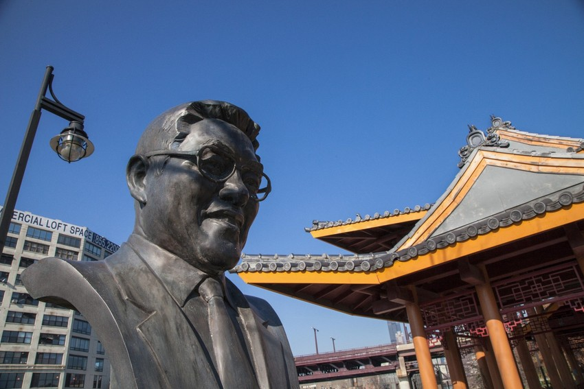 A statue of businessman and civic leader Ping Tom in the Chinatown park that bears his name. (WBEZ/Shawn Allee).