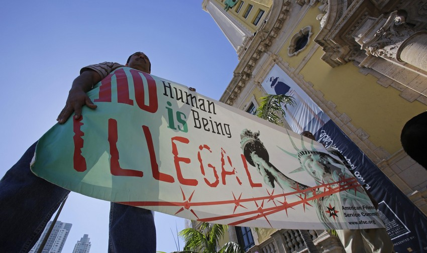 File: Immigration reform activists hold a sign in front of Freedom Tower in downtown Miami, Monday, Jan. 28, 2013. (AP/File)