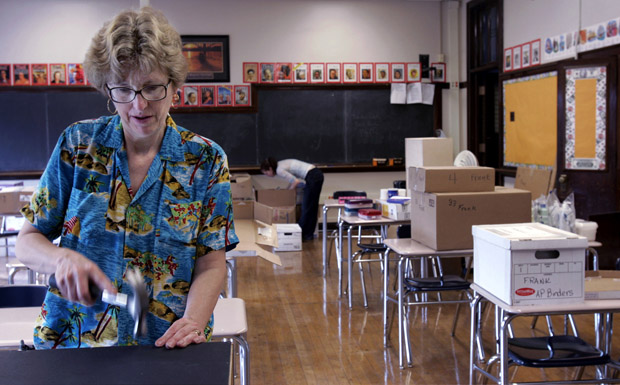 A teacher sets up her classroom at Bronzeville Scholastic High School, one of Chicago's first Renaissance 2010 schools. Chicago Public Schools says it wants 100 more new schools in the next five years. (AP/Charles Rex Arbogast)