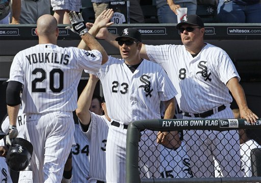 Chicago White Sox's Kevin Youkilis, left, celebrates with manager Robin Ventura, center, and bench coach Mark Parent after hitting a two-run homer. (AP/Nam Y. Huh)
