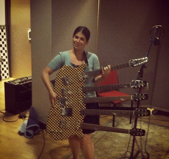 Unduly modest, Robin doesn't pose for many Sound Ops pictures, but here she is with Rick Nielsen's guitar.