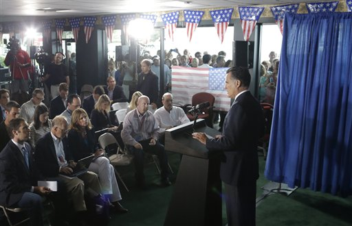 Mitt Romney addresses the press. (AP)