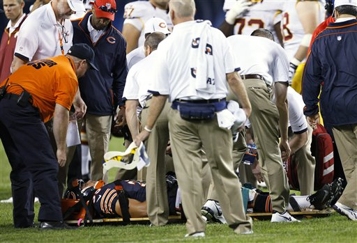 Rookie safety Brandon Hardin being taken off the field last week. The Bears need to get through Friday's game without injury. (AP/Charles Rex Arbogast)