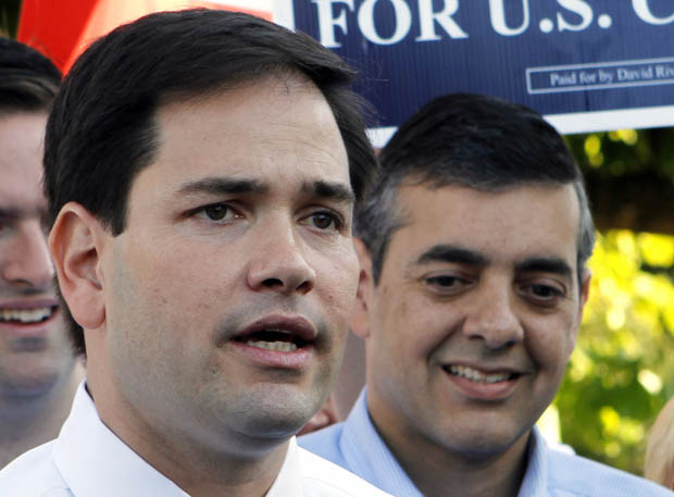 Florida U.S. Sen. Marco Rubio, left, campaigning for embattled Rep. David Rivera, right, in 2010. Rivera is being investigated for allegedly running a shadow campaign in his quest for reelection. (AP/Alan Diaz, file)
