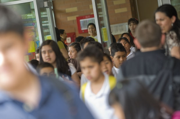 A sea of Latino students exit their elementary school in Brighton Park. (WBEZ/Bill Healy)