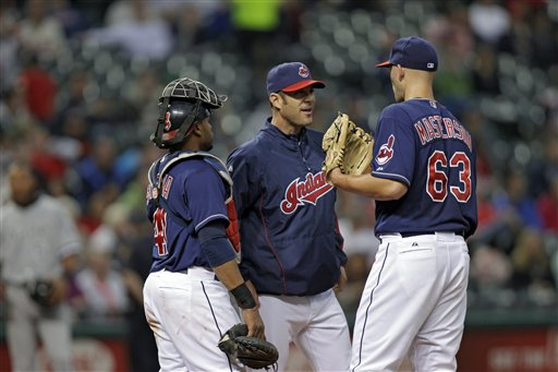 Cleveland Indians pitching coach Scott Radinsky, middle, with Justin Masterson and Carlos Santana. (AP/Mark Duncan)