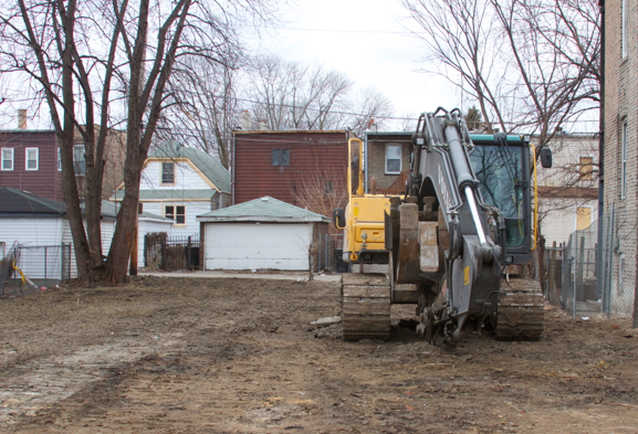 Construction equipment remains on the site of a home demolished by the city. (WBEZ/Tricia Bobeda)
