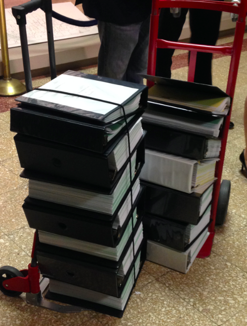 Some of Mayor Rahm Emanuel's City Hall allies piled audit documents on two dollies as part of a campaign stunt this week. (WBEZ/Lauren Chooljian)