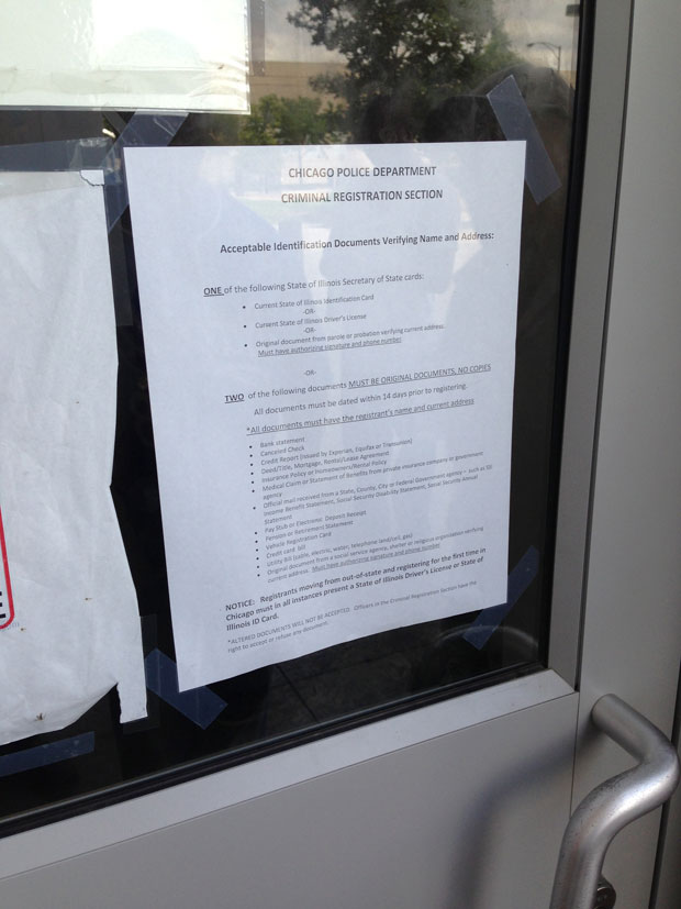 A sheet of paper hanging on the door of the criminal registration office outlines forms of ID Chicago police will now accept from sex offenders trying to register. Previously Chicago police turned men away if they didn't have proper ID.
