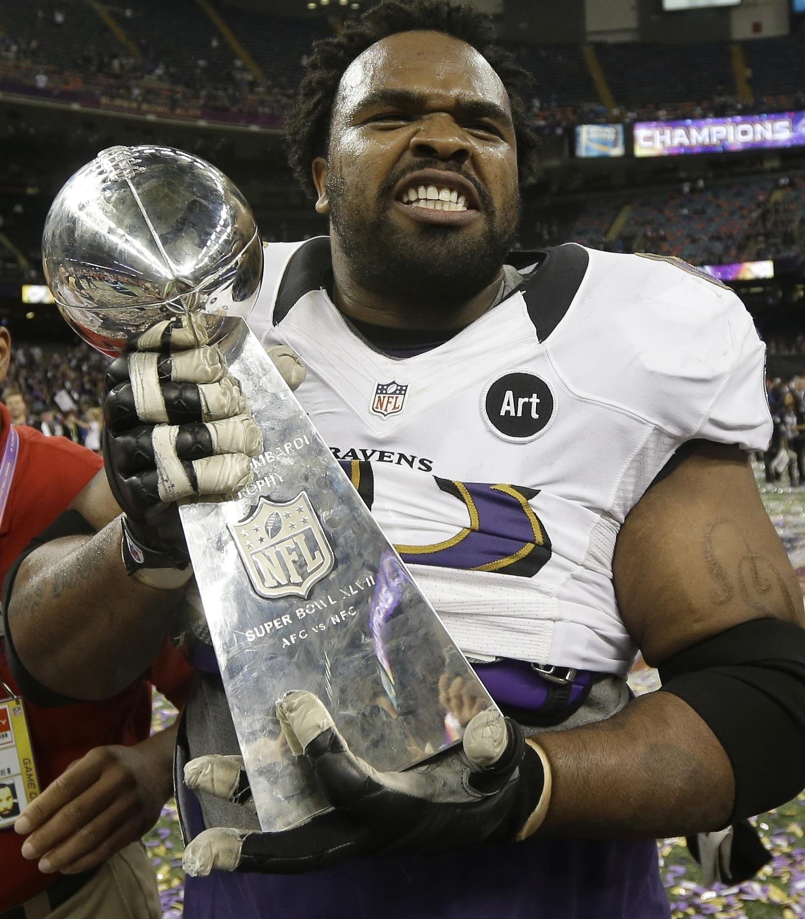 The Ravens' Bobbie Williams with the Vince Lombardi Trophy (AP / Marcio Sanchez)