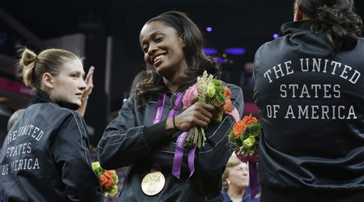 Swin Cash, center, receives her gold medal in the 2012 Olympics. (AP/Eric Gay)