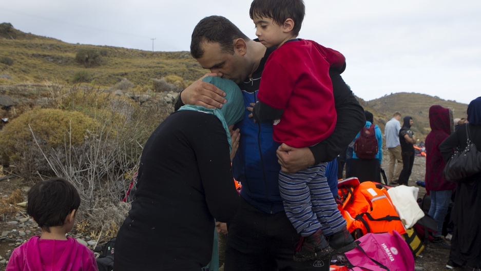 A Syrian refugee family embraces following their arrival on the Greek island of Lesbos after crossing a part of the Aegean Sea from the Turkish coast September 29, 2015. A record number of at least 430,000 refugees and migrants have taken rickety boats across the Mediterranean to Europe according to International Organization for Migration figures. (REUTERS/Dimitris Michalakis)