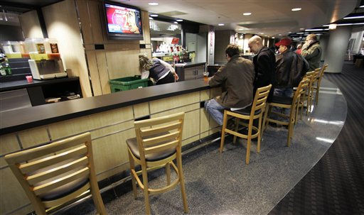 The UC bar stools may be empty at Blackhawks games for a while. (AP/M. Spencer Green)