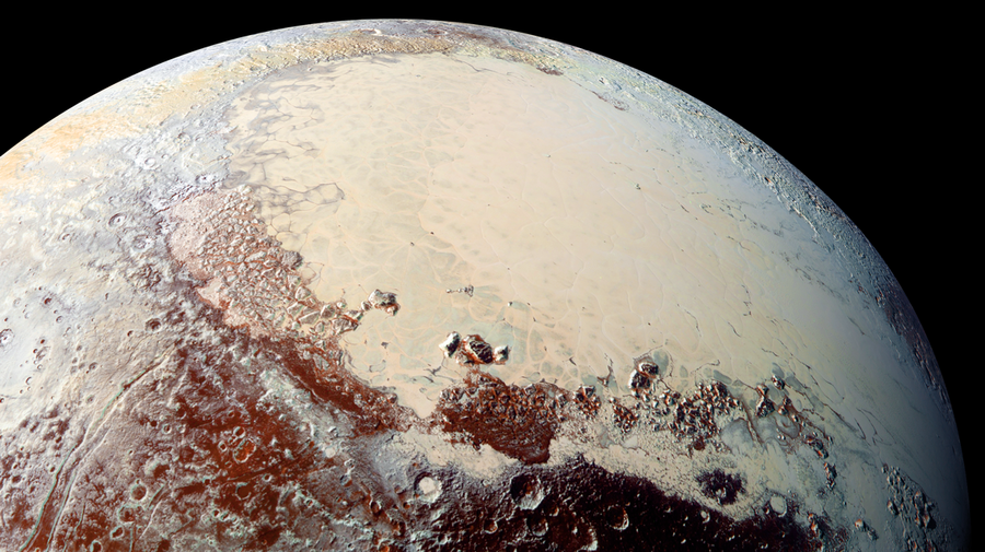 The heart-shaped glacier on Pluto's surface is made of nitrogen, carbon monoxide and methane. Researchers aren't sure how it formed. (NASA/JHUAPL/SwRI)