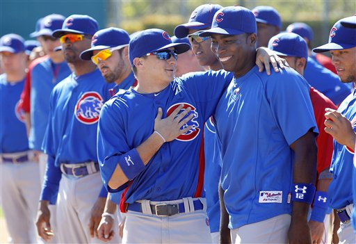 Campana puts his arm around teammate Alfonso Soriano during spring training. (AP/Ross D. Franklin)